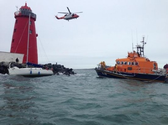 Grounded yacht rescue at the entrance to Dublin Port, Ireland. Credit: RNLI/Dun Laoghaire