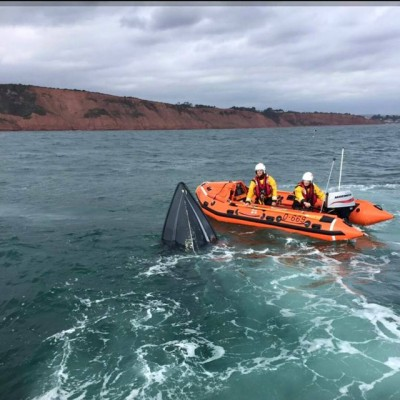 The 18ft powerboat sinking off the Exmouth coast. Credit- Crew volunteer Tim Barnes onboard the R and J Welburn