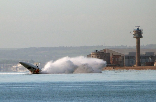The speedboat hitting the bouy while flipping in the air. Credit: Daniel Ubertini/Solent News