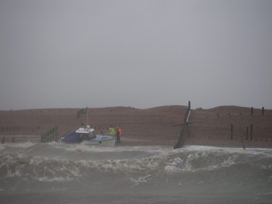 Cabin Cruiser aground off the Mary Stanford Lifeboat House at Winchelsea Beach. Credit: RNLI Rye Harbour/Tim Dickinson