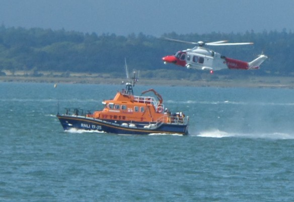 Yarmouth Lifeboat with the Search and Rescue Helicopter. Credit: RNLI/Claire Hallett