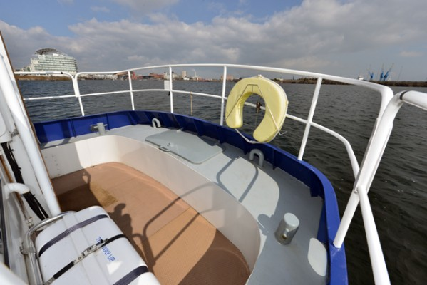Tug Yacht 33 - Curved stern option includes a bench seat