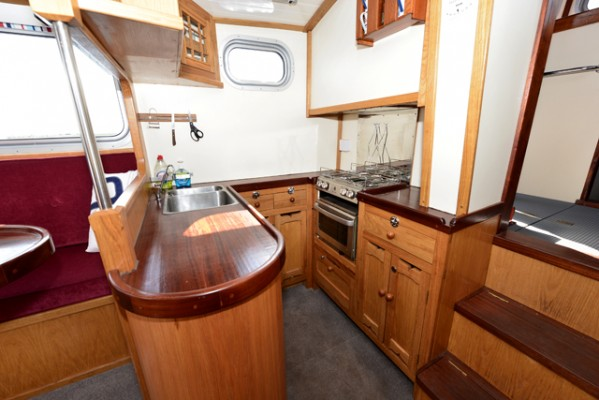 Tug Yacht 33 - the well-equipped galley includes a gas oven, hob and grill