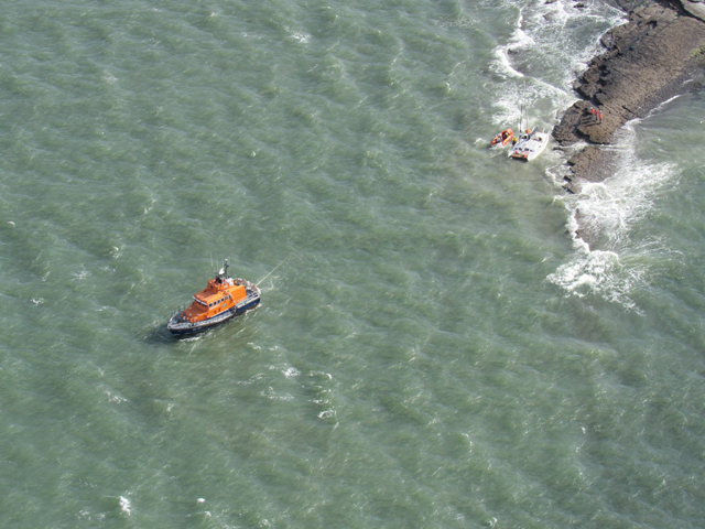 Dunmore East and Fethard RNLI with the grounded yacht off Hook Head. Credit: Rescue 117/Irish Coast Guard