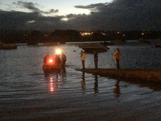 Exmouth RNLI Crew volunteers pass over the four casualties to awaiting coastguard and police teams at Topsham. Credit: Devon & Cornwall Police