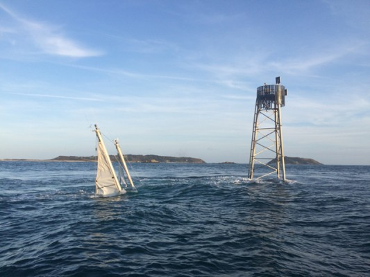 Melina of Fleet sunk at Roustel beacon, Guernsey (Herm Island in background). Credit Tom Harvey