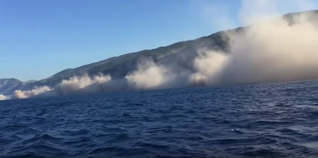 The landslides that affected Egremni Beach, Lefkada were captured on a video by a fisherman who was located on a boat just off the coast