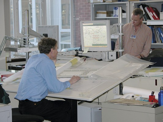 The United Kingdom Hydrographic Offi ce cartographers use computers and massive graphics tablets to create and modify their charts