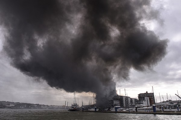 Fire at a car workshop near the Medina Boat Yard, Cowes, Isle of Wight. Credit: Rick Tomlinson