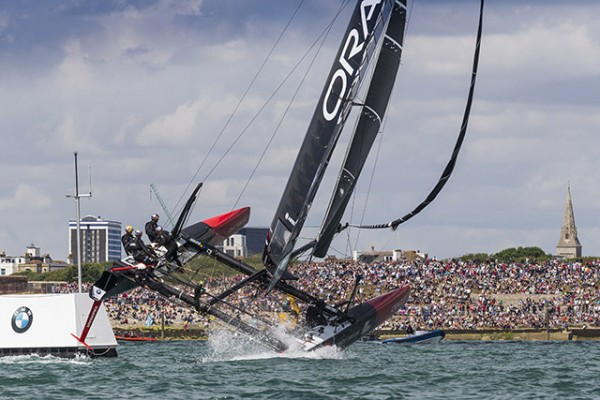 Oracle Team USA fly out the water in front of the Portsmouth crowd. Credit Ian Roman