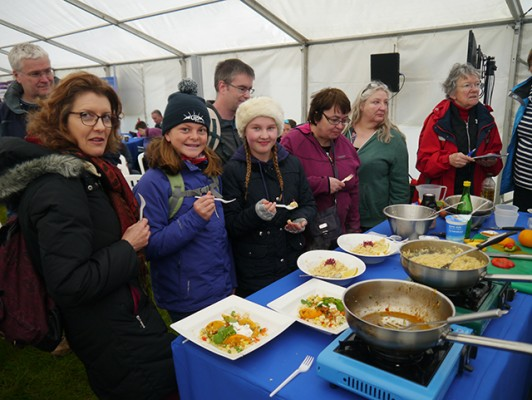 Visitors enjoy sampling dishes by David Wells from South Devon College's demonstration at PBO Ask the Experts Live at Beaulieu Boatjumble 2016