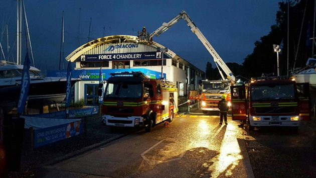Firefighters tackle the fire at Deacons Boatyeard. Credit: Hampshire Fire and Rescue Service