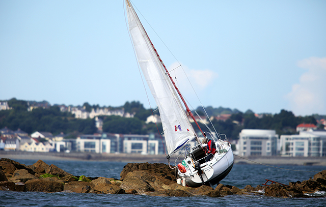 French yacht aground on Brehon Tower rocks. Credit: Peter Frankland