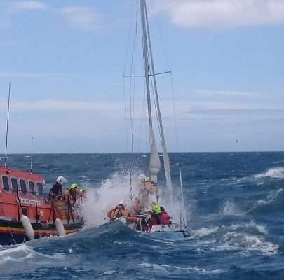 Ramsey RNLI Lifeboat and the stricken yacht. Credit RNLI/Tony Radcliffe
