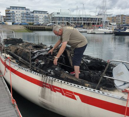 Saying farewell - Robert Thornewill aboard the charred remains of Eleanor C
