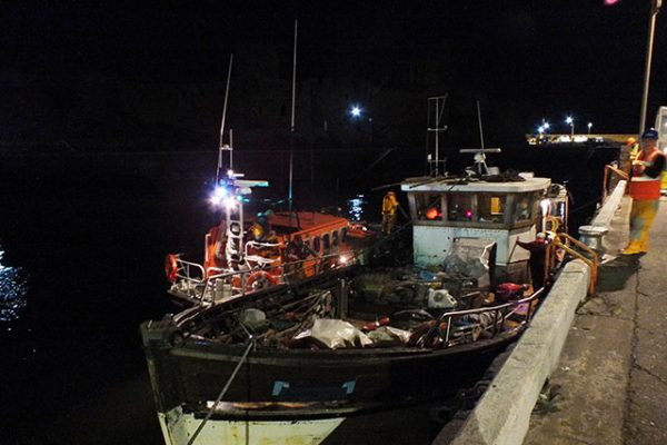 The converted fishing trawler safely in Peel harbour. Credit: RNLI/Mal Kelly
