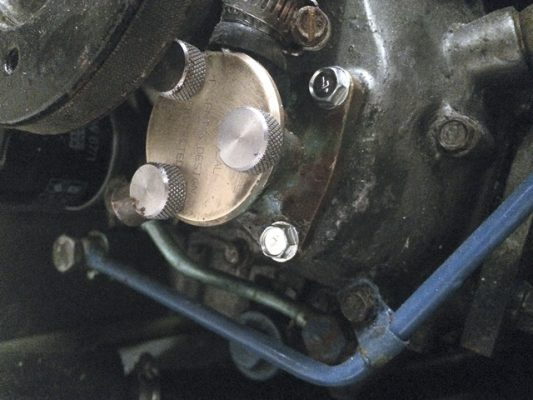 16: The pump, refitted to the engine. Upon starting the engine, it was drip-free!