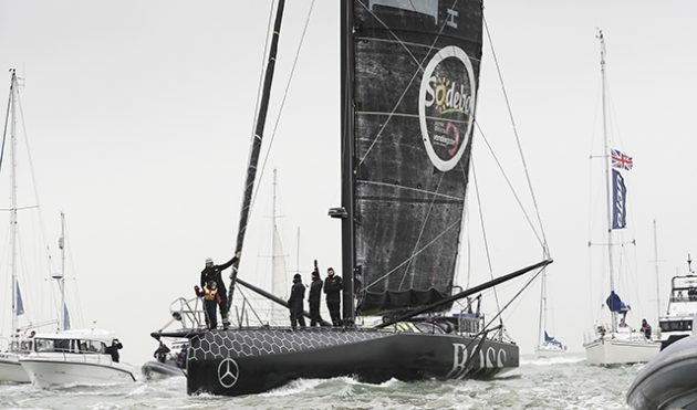 Alex Thomson aboard his Hugo Boss race yacht at his homecoming parade. Credit: Lloyd Images