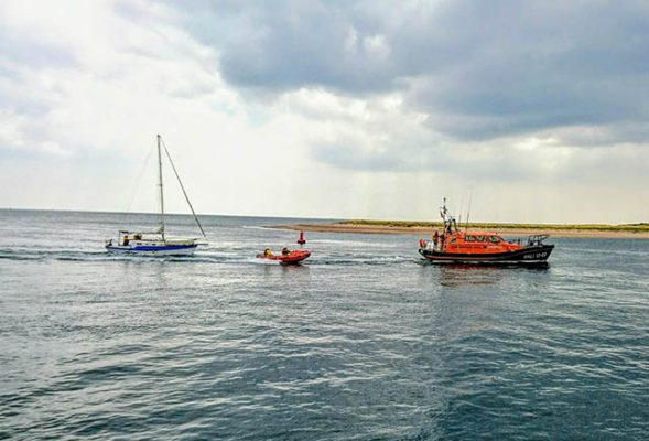Exmouth's Shannon lifeboat towing yacht with D class alongside. Credit: RNLI/Emma Tarling