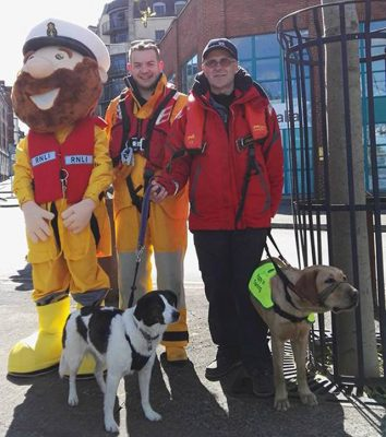 The RNLI's Stormy Stan pictured with sailor Chris Egan and Brian Curtin, RNLI Community Fundraising Manager and Valentia RNLI crew member. Credit: RNLI/Len Lloyd