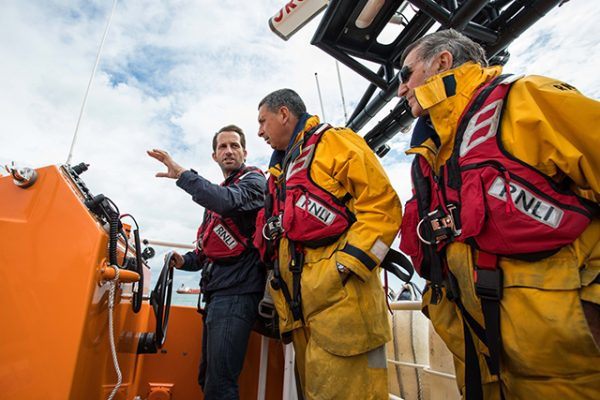 Sir Ben Ainslie with Bembridge RNLI crew members. Credit: RNLI/SVYC/Harriet Hadfield