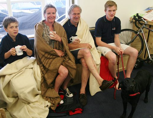 The rescued family (L-R Theo, Tania, Joe, and Hector Coles with dog Suki). Credit: Jade Dyer/RNLI/Lyme Regis