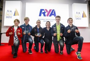 Young sailors and boaters with their RYA awards