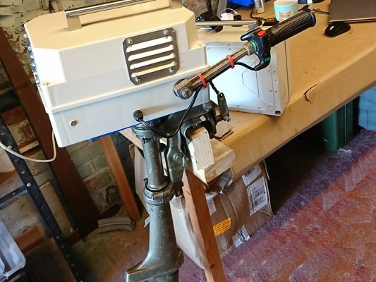 The finished electric outboard on the bench  at home