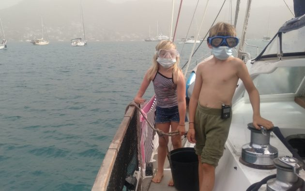 Braca (9) and Ayla (7) onboard protect themselves from the ash