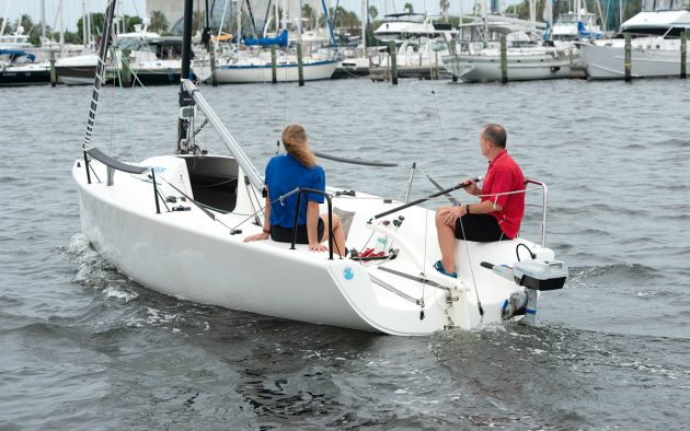 Portable electric outboards have no trouble moving even quite large hulls with relatively little power. This is an ePropulsion 1kW unit pushing a day sailer quite happily. Photo: Bill Doster