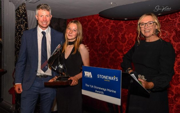 From left: Stu Bithell, Katie McCabe with her YJA Stoneways Marine Young Sailor of the Year trophy, and Shirley Roberton OBE.