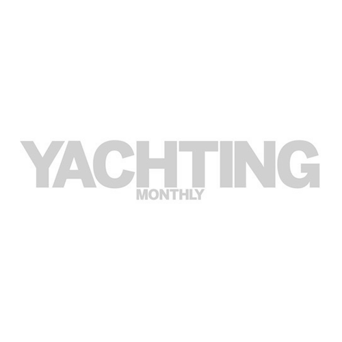 A yacht sailing in a shipping lane