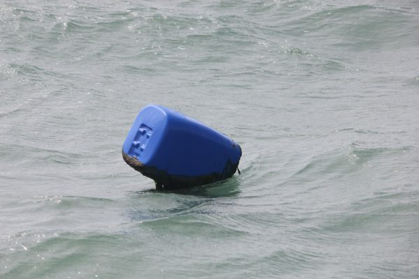 A blue container marks the location of fishing gear