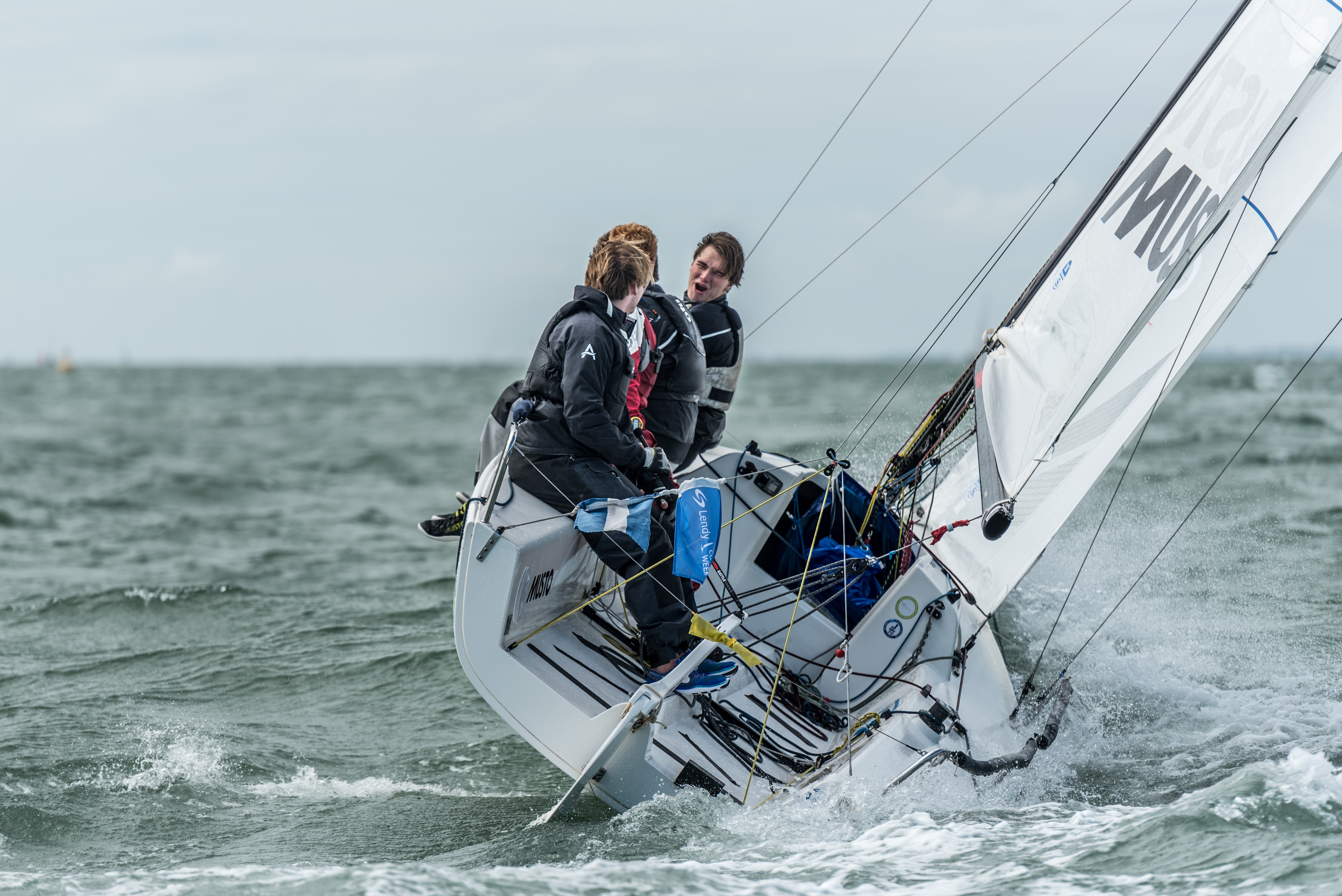 Sailors wearing Musto gear in a sailing boat. The firm has been bought by Helly Hansen
