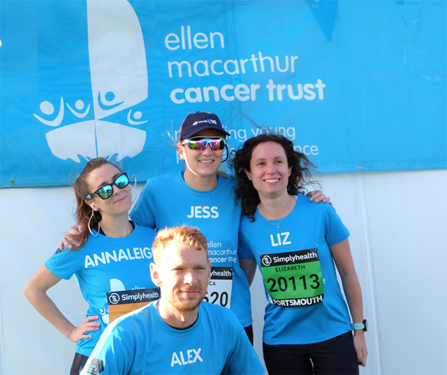 Four people dressed in blue Ellen MacArthur Cancer Trust T-shirts