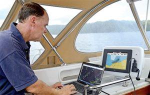 A man looks at a Navionics chart