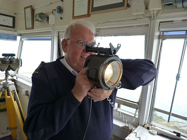 A watchkeep with the NCI used an Aldis lamp to signal Morse Code to a yacht in danger