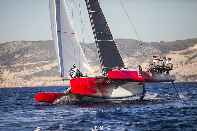 A red foiling trimaran
