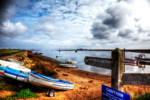 Boats pulling up on the foreshore in Wells, Norfolk
