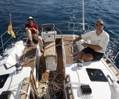 Two men on a boat sailing