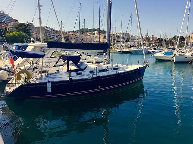A blue yacht in a marina