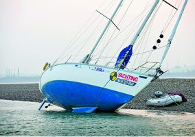 A yacht aground on mud flats