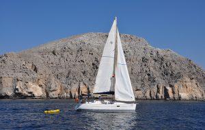 A white Jeanneau with while sails
