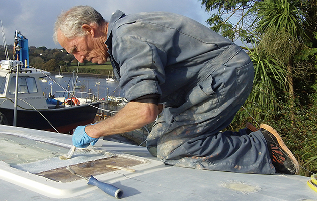 A golden globe entrant Robin Davie in overall working on his boat