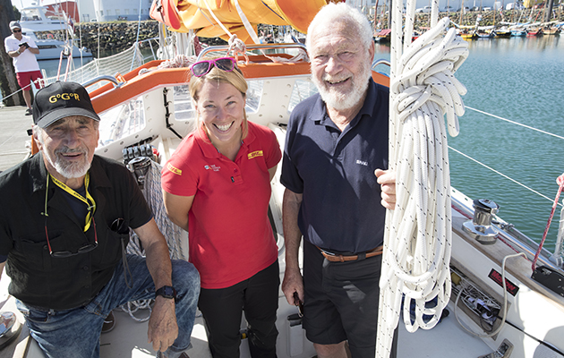 Susie Goodall in red meets Sir Robin Knox-Johnston and Alex Carozzo