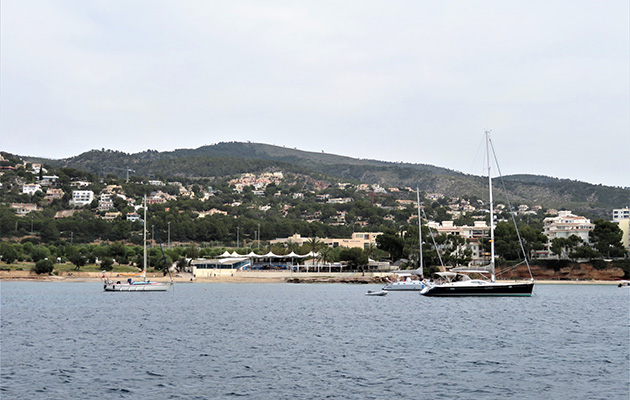 Yachts moored outside Puerto Portals