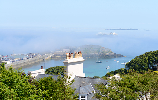 Fog rolls in over Castle  Cornet, Guernsey – a  common occurrence in the Channel Islands. Credit: Alamy