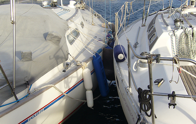Two yachts colliding with fenders