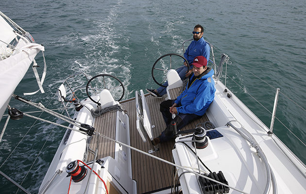 Two men in the cockpit of the Beneteau Oceanis 30.1