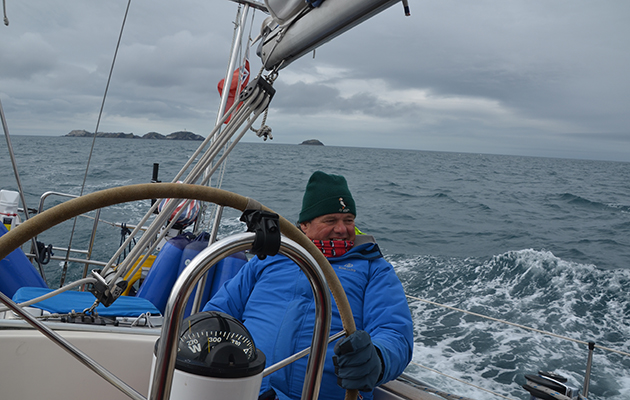 Jonty Pearce at the helm while sailing in Scotland